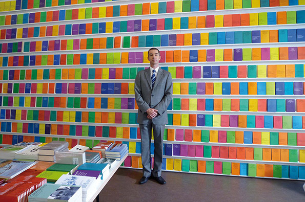 Man in front of organized wall